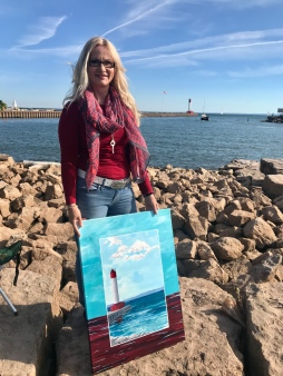 Dawn-Angela Seeley with painting